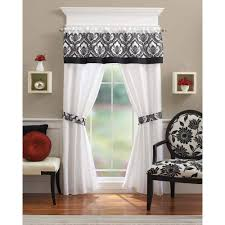 interior white crest home design curtains with floral detail on