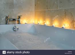 bathroom showing bath fitted with chrome bath and shower taps