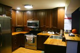over refrigerator cabinet lowes kitchen remodel cabinet painting contractors hbe before and after