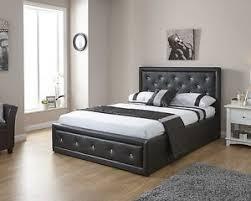 double 4ft6 faux leather ottoman storage bed diamante double