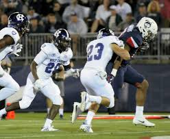 uconn football team comes from behind to beat holy cross new