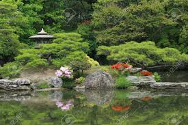 beautiful japanese garden with pond and ornaments stock
