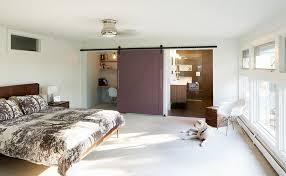 bedrooms bedroom idea with barn sliding door to bathroom