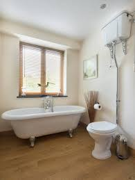 Bathroom Designs With Clawfoot Tubs White Acrylic Freestanding Tub And Rounded Brown Wooden Stool Also