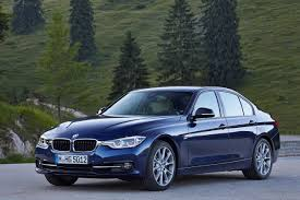 dark green bmw bmw 320i introduced in india starts at inr 36 90 lakhs