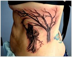 black with scythe and tree on ribs tattoos book