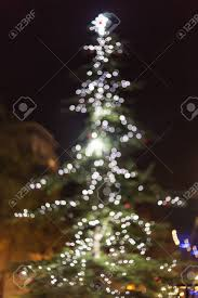 christmas tree shaped lights defocused christmas tree lights circle shaped bokeh stock photo