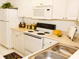 White Kitchen Cabinets White Appliances by Kitchen Remodeling Where To Splurge Where To Save Hgtv