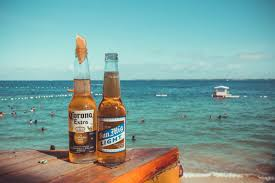 top 5 light beers free photo two corona extra and san mig light beers on top of brown