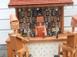 bill and ben sat at pub table wooden garden ornament with solar