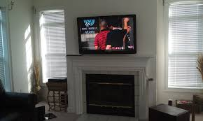 decoration mounting tv above fireplace decor with grey wall for
