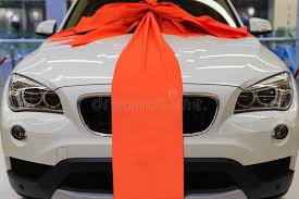 large ribbon brand new white present car with large ribbon decoration stock