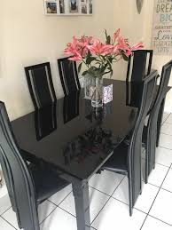 black glass dining room table harvey s noir range extendable black glass dining table in selby