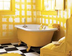 yellow tub yellow bathroom black and white tile floor black and