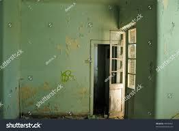 empty room textured peeling paint wall stock photo 44699467