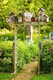 birdhouse garden arbor brick path garden arbours and arbors
