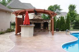 Building A Pergola On Concrete by Poolside Retreat Outdoor Livingroom With Bar And Fireplace Under