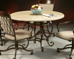 metal top round dining table round cream wooden dining table on carved brown metal legs and brown