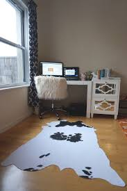 Rug On Laminate Floor Decorating Exciting Cow Hide Rug On Kahrs Flooring And Stone