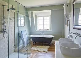 green bathroom with metro tiled shower and roll top bath cottage
