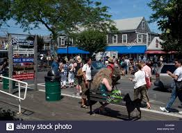 people arrive in provincetown from the ferry from boston at the