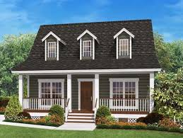 home plans with front porches picture of house with porch across front and white railing small