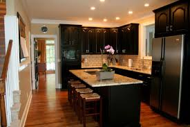 wonderful black kitchen cabinets with white and dark countertops