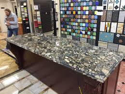 island in black marinace granite looks like river rocks would
