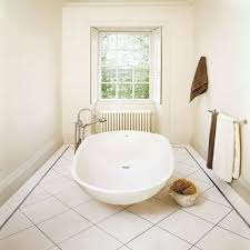 bathroom modern white toilet on dark brown bathroom floor tile