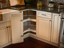 kitchen corner cabinet ideas a corner cabinet door opens to reveal a kidney shaped lazy susan