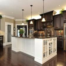 wood kitchen cabinets with white island cab white island floors pendents traditional