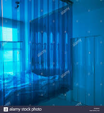 Suspended Bed by Suspended Bed Enclosed With Blue Plastic Curtain In Modern Bedroom