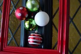 front door wreath framed ornaments its overflowing
