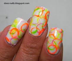 deez nailz neon circle nail art with kozmic colours
