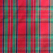 what is tartan plaid red and green plaid one inch piece of fabric material red and green
