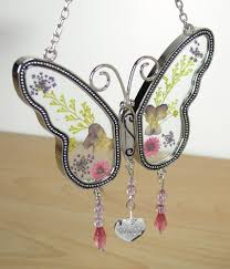 butterfly suncatcher with pressed flower