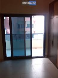 room and wooden partitions shared apartment room dubai