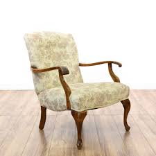 Upholstered Accent Chairs by This Accent Chair Is Upholstered In A Durable Beige Fabric With A