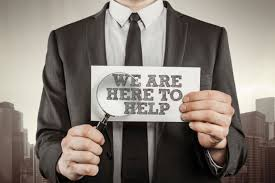 career builder resumes how to avoid being a tech support scam victim aarp man in suit holding we are here to help sign