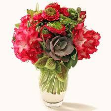 Red Flowers In A Vase Garlands Florist