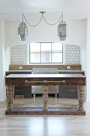 freestanding reclaimed wood kitchen island with brass towel bar