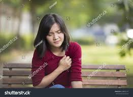 woman has chest pain sitting on stock photo 358802147 shutterstock