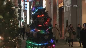 man runs around tokyo dressed as a christmas tree cnn