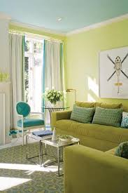 green sofa yellow walls turquoise http
