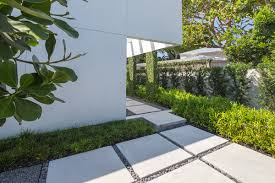 poured concrete home tropical minimal by craig reynolds landscape architecture photo