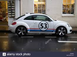 new volkswagen beetle a vw new beetle in herbie livery stock photo royalty free image
