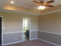 i like the tray ceiling and two tone walls with chair rail to room