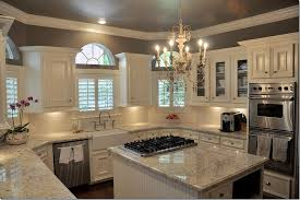 loooove this kitchen granite is bianco romano color of the walls