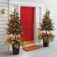 prelit christmas tree the estate door prelit christmas tree planter hammacher schlemmer