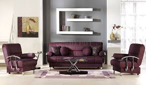 stylish living room with storage sleeper sofa in burgundy fabric